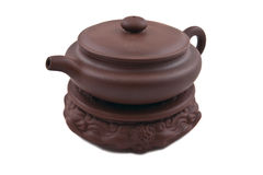 Brown ceramic teapot on stand Royalty Free Stock Images