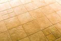 Brown ceramic tiled floor background Royalty Free Stock Photos