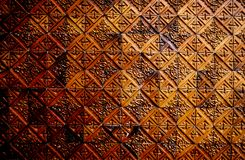 Brown ceramic tiled wall. Backgroud, textures stock photography