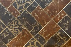 Brown ceramic tiles with an abstract pattern royalty free stock photography