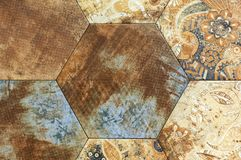 Brown ceramic tiles with a rust effect. Background of ceramic tiles royalty free stock image