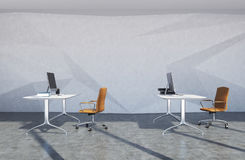 Brown chair office interior. Modern office interior with concrete walls and floor, white computer tables and brown chairs standing near them. 3d rendering mock Stock Image