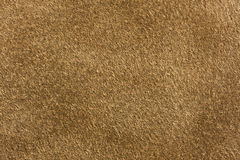Brown chamois leather. Textured  background Royalty Free Stock Photo