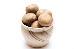 Brown champignons in the pot Royalty Free Stock Image