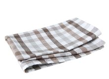 Brown checkered folded kitchen cloth isolated. Royalty Free Stock Image
