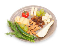 Brown cheese plate with almonds, fennel, olives, red peppers, ch Stock Photo