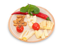 Brown cheese plate with almonds, fennel, olives, red peppers, ch Royalty Free Stock Photography