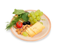 Brown cheese plate with almonds, fennel Stock Photography
