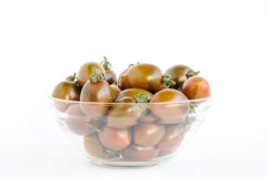 Brown cherry tomato - Grape Kumato in glass bowl, isolated Royalty Free Stock Photography
