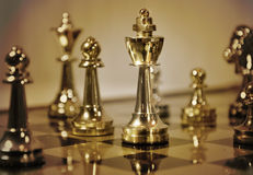 Brown Chess Game with King. A closeup of a chess game with a king piece. Color scheme is brown. Use it to represent business strategy, competition or playing a Royalty Free Stock Photography