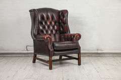 Brown chesterfield Royalty Free Stock Photography
