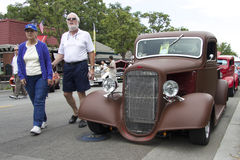 Brown Chevy pickup truck 1936 and an elderly couple Royalty Free Stock Photography