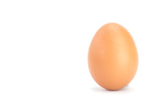 Brown chicken egg isolated on white. Close up brown chicken egg isolated on white background Royalty Free Stock Photos
