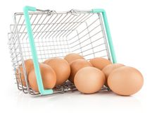 Brown chicken egg isolated on white. Brown chicken eggs out a shopping basket isolated on white background raw Royalty Free Stock Photography