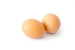 Brown chicken egg on white. Stock Image