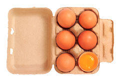 Brown chicken eggs in cardboard box container Stock Photos
