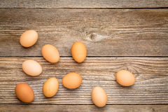 Brown chicken eggs on rustic wood Royalty Free Stock Images