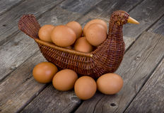 Brown eggs in chicken basket Stock Photo