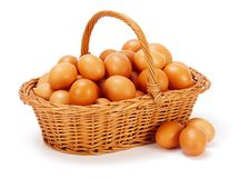 Brown chicken eggs in basket Stock Photos