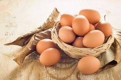 Brown chicken eggs. Brown chicken eggs on wooden table Stock Photos