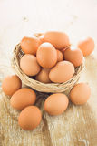 Brown chicken eggs. Brown chicken eggs on wooden table Stock Photo