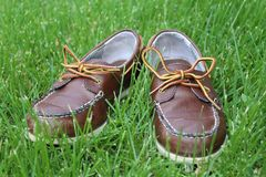Brown Child Shoes in Green Grass.  Royalty Free Stock Images