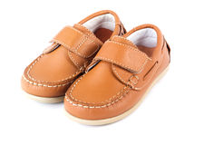 Brown Children's moccasins. Brown baby moccasins on a white background Stock Photos