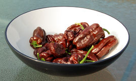Brown chili pepper fruits in bowl Stock Image