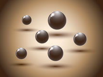 Brown chocolate balls on colorful background. Royalty Free Stock Images