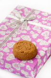 Brown chocolate cookie on the pink gift box Stock Image