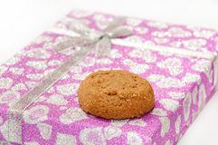 Brown chocolate cookie on the pink gift box Stock Images