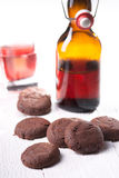 Brown chocolate cookies. With juice Stock Photos