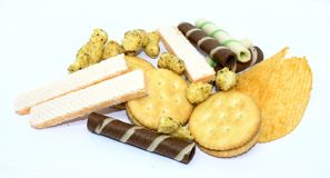 Mixed snack on white background royalty free stock images