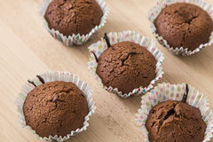 Brown chocolate muffins on a wooden background Royalty Free Stock Image
