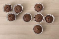 Brown chocolate muffins on a wooden background Royalty Free Stock Photo