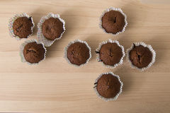Brown chocolate muffins on a wooden background Royalty Free Stock Images