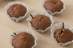 Brown chocolate muffins on a wooden background Royalty Free Stock Photography