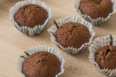 Brown chocolate muffins on a wooden background Stock Image