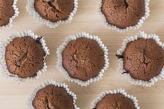 Brown chocolate muffins on a wooden background Stock Photo