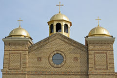 Brown Christian Church with Three Gold Domes Royalty Free Stock Image