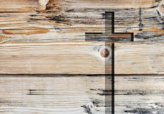 Brown christian religion symbol cross. Brown old christian religion symbol cross shape as sign of belief on a grungy textured church wall or rustic aged stock photography