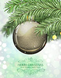 Brown Christmas ball. And fir tree branches on a sparkling  holiday background. Festive Christmas background Stock Photography
