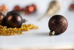 Brown Christmas balls and golden beads Stock Photo