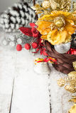 Brown Christmas basket with silver and gold toys on a white wooden background Stock Photography