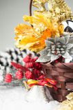Brown Christmas basket with silver and gold toys on a white wooden background Stock Photos