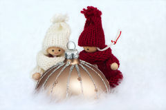 Brown christmas bauble with puppets Stock Photo