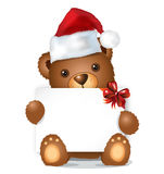 Brown christmas bear with card sitting Stock Photos