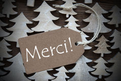Brown Christmas Label With Merci Means Thank You Stock Image