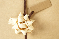 Brown christmas present. Beautifully naturally wrapped gift with label and copy space Stock Photo