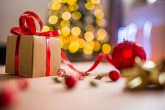 Brown Christmas Present With Red Ribbon Royalty Free Stock Photo